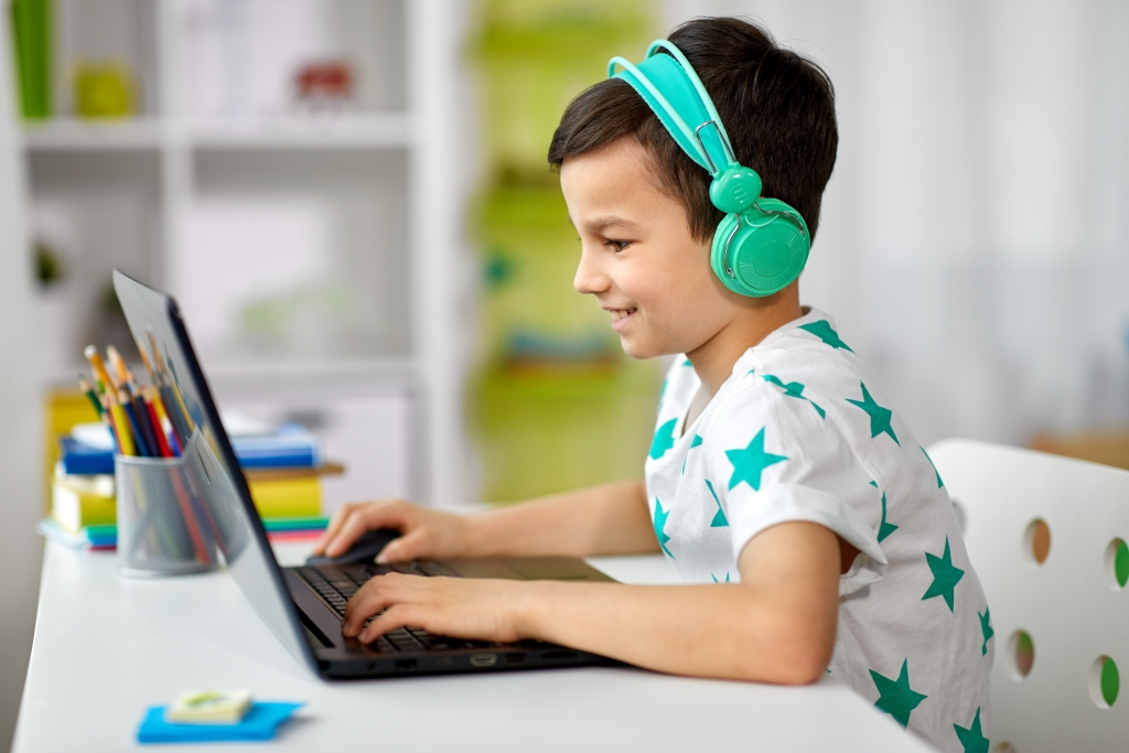 Child Making Music in Computer